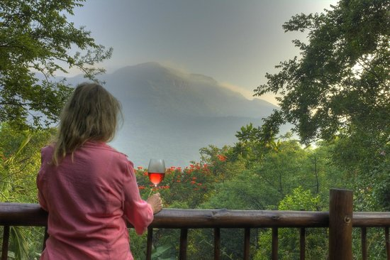 Old Joe's Kaia: The famous and spectacular view of the mountain from the main balcony with African Flame flowers