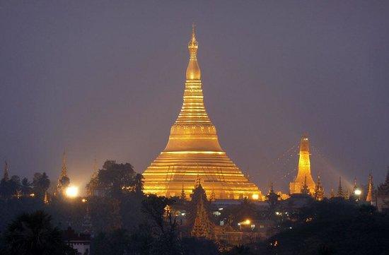 Alfa Hotel:                   Shwe Dagon Pagoda taken at dusk from the roof-top bar.