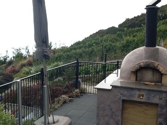 A Culinary Experience Luxury B and B:                   pizza oven on one of the outside decks
