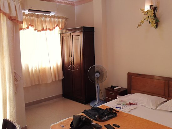 Titi Hotel:                   roomy with fan, aircon and wardrope