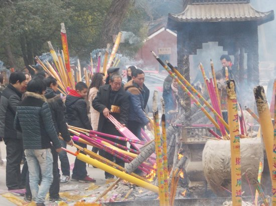 Tianshui, China: Pilgrims burning incense