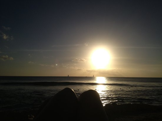The Club, Barbados Resort & Spa All Inclusive:                   Sun set on the beach while on sunbed reading book