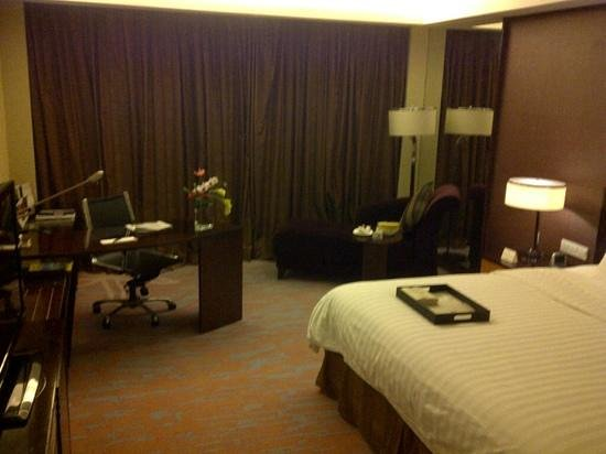 New Century Grand Hotel:                   spacious room with complimentary fresh fruits daily
