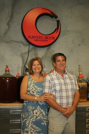 Hunters Moon Meadery: owners Kim & Greg underneath their logo sign