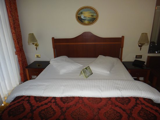 Amber Hotel:                   Full size bed in triple room.