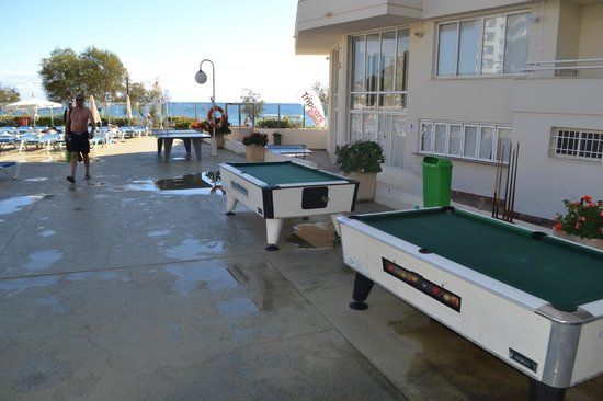 Playa Dorada Aparthotel: Pay Per Play Pool Tables Outside After A Rainy  Night