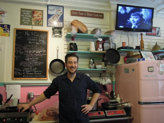 Sweetie's Bakery & Cafe:                   Proud Cook/Owner next to his green ham!