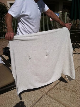 Scottsdale Resort & Athletic Club:                   old towels at poolside with holes in them