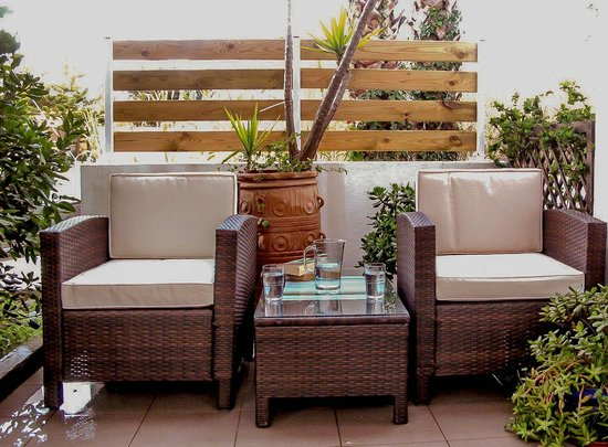 Anna Plakias Apartments: apartment balcony with bamboo armchairs