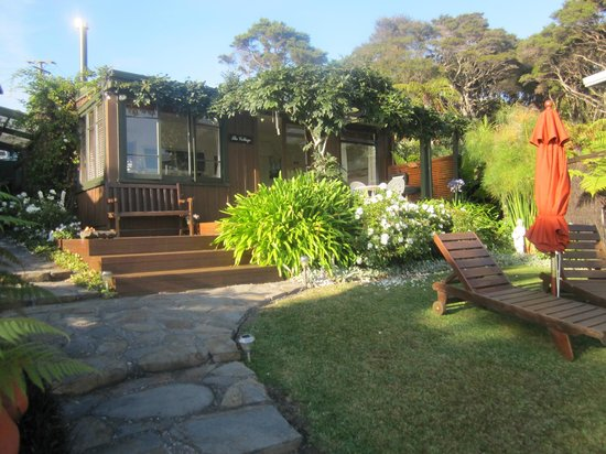 Waters Edge Holiday Accommodation :                   View of the Cottage .