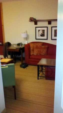 Residence Inn Florence: View from living room into area outside bedroom and into bathroom sink area. Has a closet .