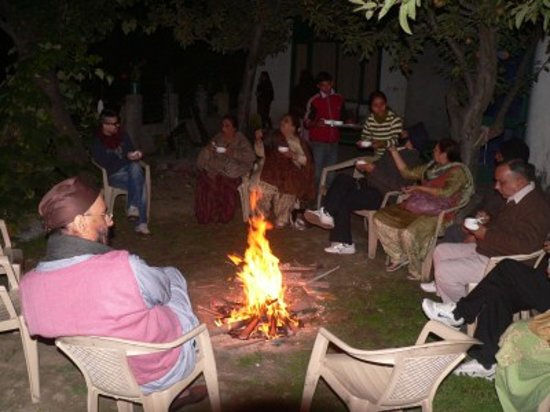 The Grand Shamba-La: Guests enjoying a wood fire during the evening