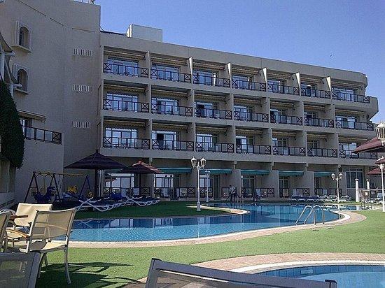 Atana Khasab:                                     the first wing (having breakfast around the pool)