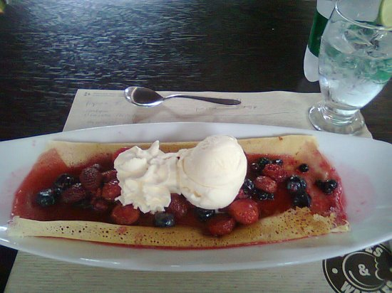 Crepes & Waffles :                   crepe with fresh berries and vanilla ice cream