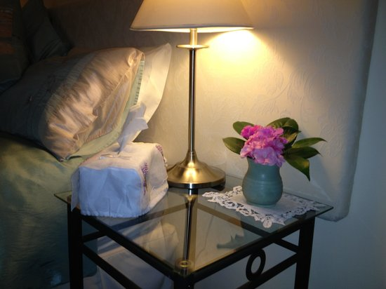 Practically Lakeside B&B:                   Fresh flowers by the bed