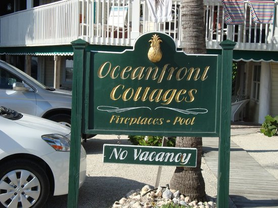 Oceanfront Cottages:                   sign in front of cottages