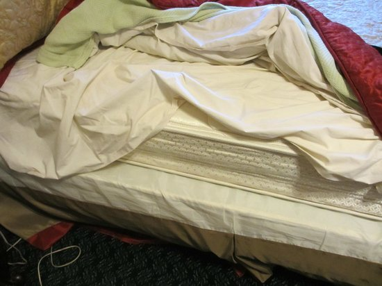The Cordova Inn:                   this is how bed was the spread was thrown over the bed mattress off bed.