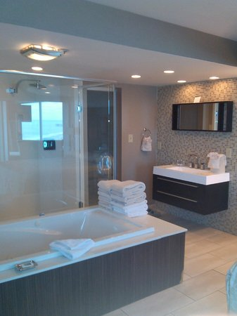 Captains Quarters Resort:                   Master bathroom with jetted tub and rainfall glass shower