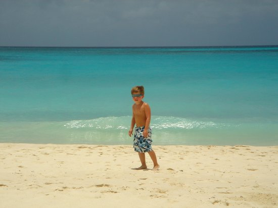 Costa Linda Beach Resort:                   Grandson walking the beach