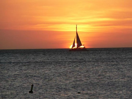 Costa Linda Beach Resort:                   sailboat during sunset