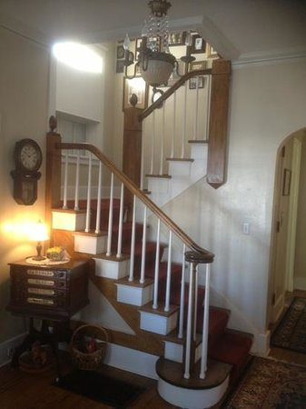 Everest Inn Bed and Breakfast :                   Exquisites antique staircase as you walk in to the foyer