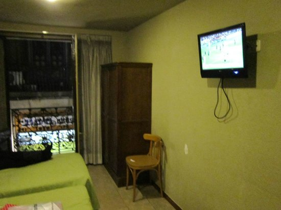 Hotel Jaume I:                                     thank god there was a window!!TV without remote control