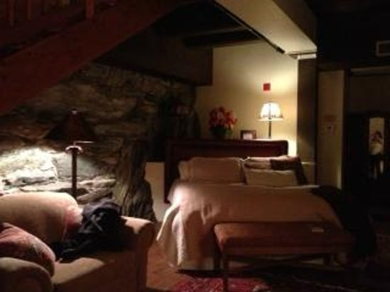The Common Man Inn :                   Stone Suite- downstairs view from gas fireplace corner toward King Bed