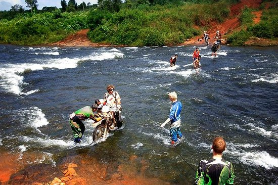 Ride Expeditions:                   A real team effort to cross this fast flowing river.