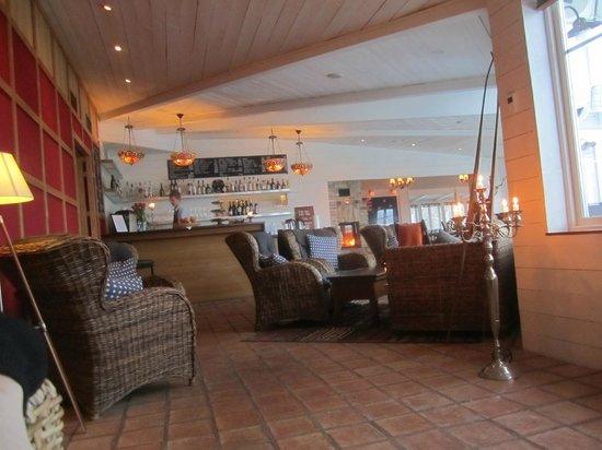 The Lodge: Lounge area; cozy w/ fireplace