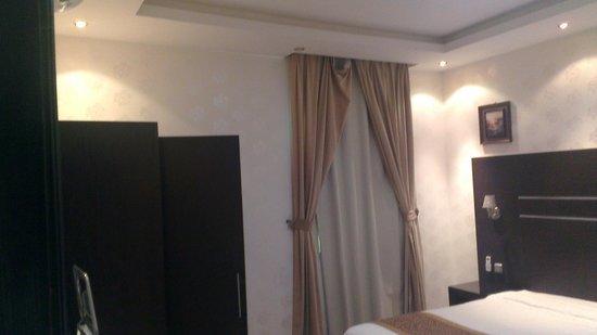 Rest Night Hotel Suites- Al Malqa :                   bedroom