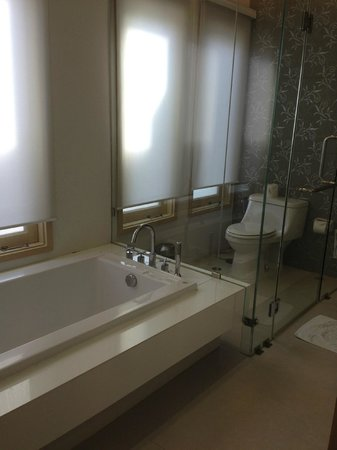 The Lapa Hua Hin Hotel :                   Bathroom, with both bath tub, toilet and shower.
