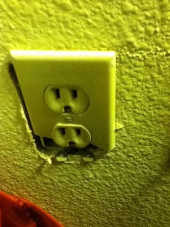 Hotel Preet Grand Conference Center :                   WALL PLUG BY BED.