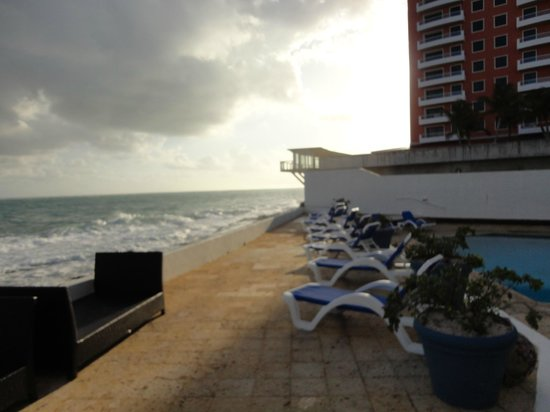 San Juan Beach Hotel:                   that building blocks the sun in the afternoon