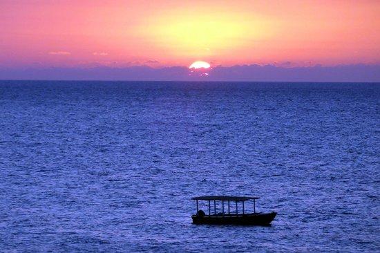 Beach House Villas:                   Every evening, a breathtaking sunset