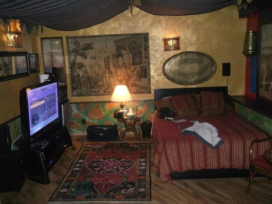 Mariaggi's Theme Suites Hotel and Spa:                   Sleeping area with t.v. surround stereo and awning style ceiling