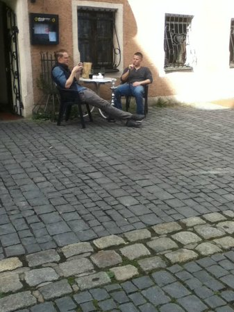 Altstadt Hotel Bräuwirt:                   A couple of guys sitting across the street from hotel where several business f