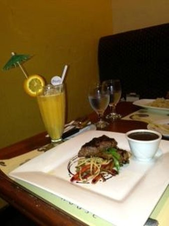 Corus Paradise resort:                   beef steak and fresh orange.