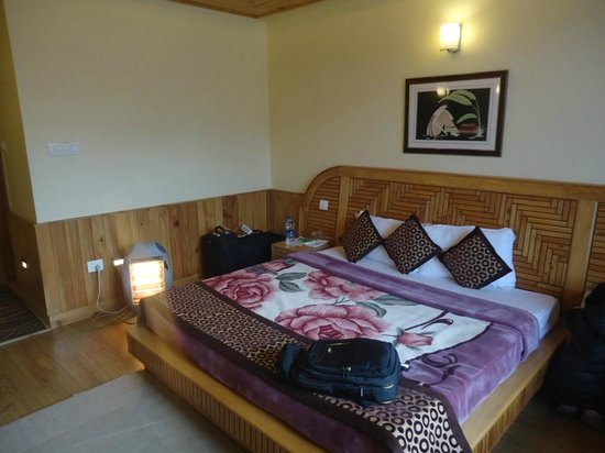 The Holiday Resorts Cottages & Spa:                   Bed with Heater