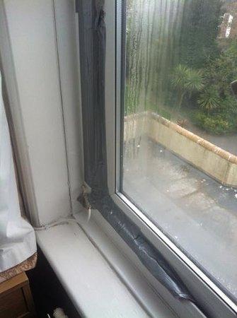 Trecarn Hotel :                   masking taped up window