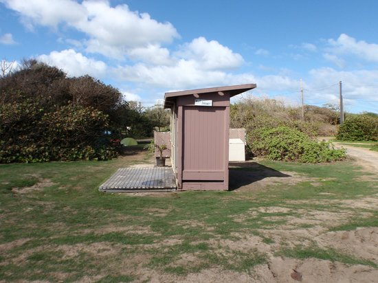Malaekahana Beach Campground:                                     One of the outdoor showers with an AMAZING view (behind me i