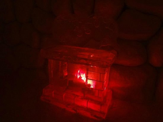 Hotel de Glace: Ice fireplace in our Love themed suite