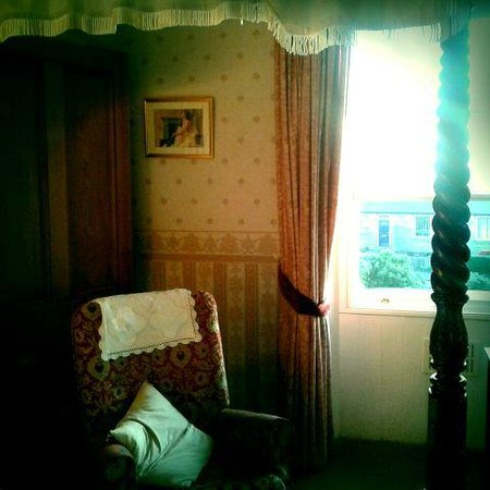 The Pines Guest House:                                     The four poster room, so cosey!
