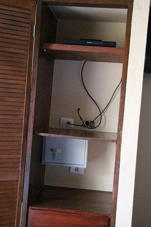 Eden Beach Resort:                   No door on these shelves to hide wires, opening in drywall