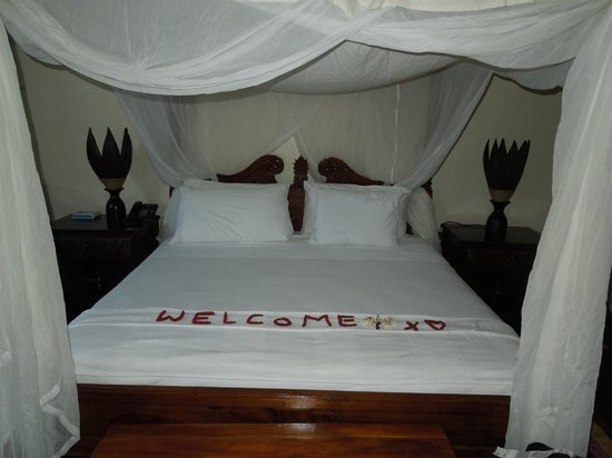 Fond Doux Plantation & Resort:                   king size bed with netting
