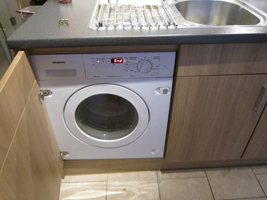 Norwich Street Apartments - Peymans :                   tiny (but great to have) washer/dryer