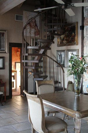 La Villa Vista:                   Spiral staircase up to the top floor. Eva's art on the walls of the dining roo
