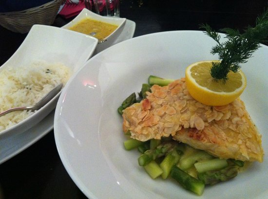 Zunft zu Webern:                   Fish with almond flakes, served with butter rice & curry