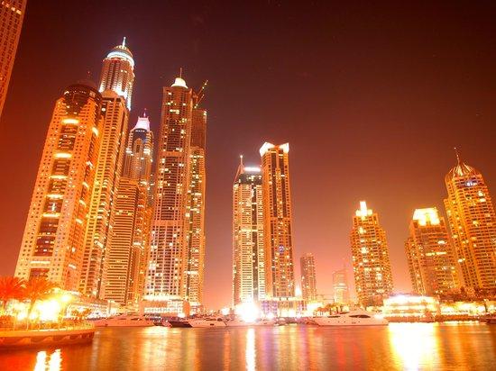 Grosvenor House Dubai:                   The Dubai Marina at night, shopping and dining 5 minutes walk from the hotel.