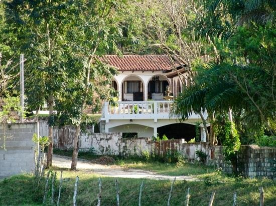 Hacienda la Esperanza:                   Zoomed in photo taken from road which runs along river.