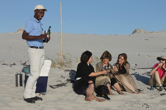 MOSAIC Lagoon Lodge:                   Sundowners on the beach with our friend Nkosana